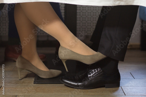 Closeup Shot Of Partners Legs Under The Table Having Business Lunch