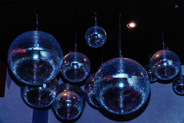 Disco balls in a nightclub room