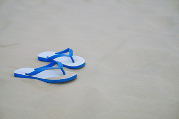 Summer, Blue old slippers or flip flops on the Sand beach