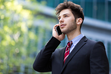 Young manager on the phone outdoor