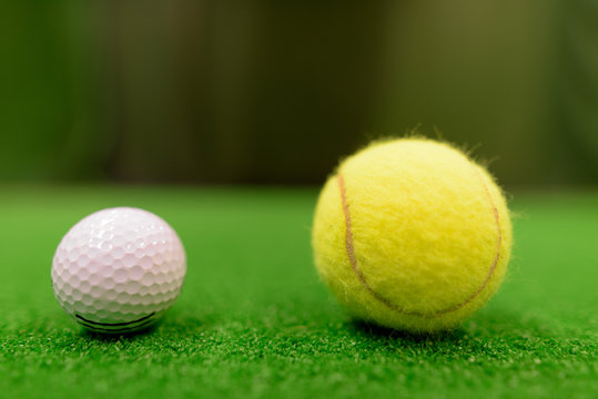 Golf Ball And Tennis Ball On Green Surface
