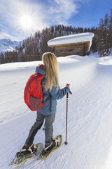 Young girl walk on the snow with snowshoes. Grevasalvas, Engadin Valley, Graubünden, Switzerland, Europe.