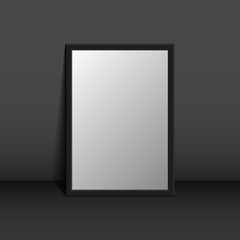 Picture frame on a black wall 3d background design for your content. Blank white paper poster in grey frame standing on a floor. Mock-up template for your design.