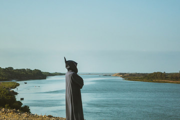 view of a local moroccan man standing in front of a river