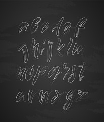 Handwritten outline English alphabet letters on chalkboard background.