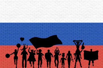 Russian supporter silhouette in front of brick wall with Russia flag