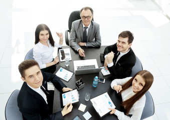 successful businessman and his business team meeting in modern office