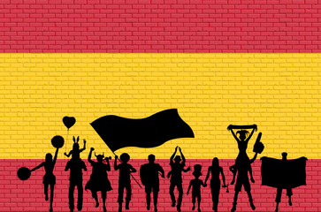 Spanish supporter silhouette in front of brick wall with Sapin flag