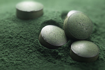 Close up of Atisanal Spirulina Tablets and Powder