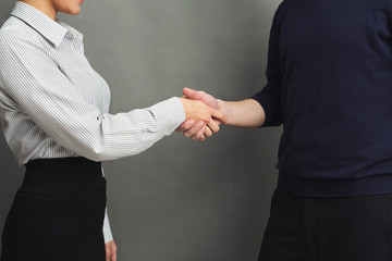 Business handshake at corporate meeting