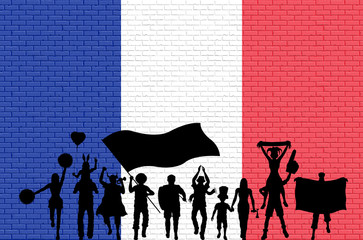 French supporter silhouette in front of brick wall with France flag