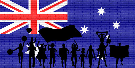 Australian supporter silhouette in front of brick wall with Australia flag