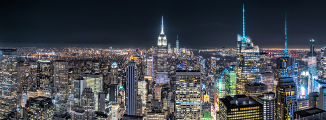 Fotomurales - Aerial view over New York City by night
