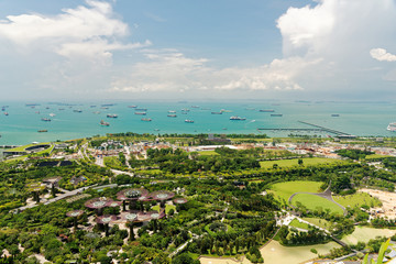 Singapore-April 2018.View from the top floor Marina Sands Hotel at Gardens by the bay and ocean in Singapore, April 2018.Editorial.Horizontal view.