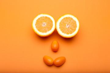 Sliced oranges and cumquats arranged as a smile face