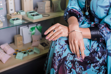 Female hands with ring and bracelets at a jewelry shop