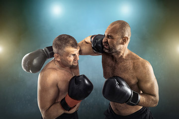 Two professional boxers, athletes in dynamic boxing action