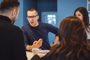 Man aggressively talking at the office meeting to his colleagues