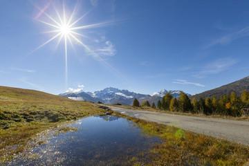 Sunburst on Cima Piazzi, Val Vezzola, Valdidentro, Valtellina, Sondrio province, Lombardy, Italy