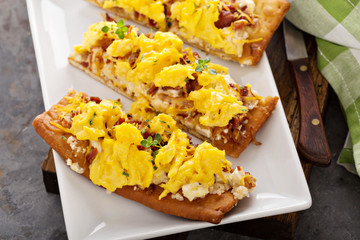 Breakfast pizza, flatbread with scrambled eggs