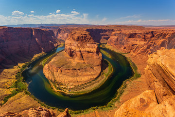 Horseshoe Bend in summer sunny day, formation in Colorado River.