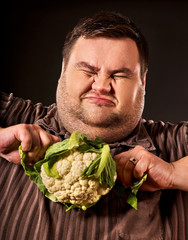 Diet fat man eating healthy food. Healthy breakfast with cauliflower vegetables. Male trying to lose weight. Dietary breakfast. Man tries to follow recommendations of dietician.