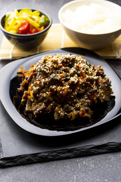 Roasted beef in sauce with spices and sesame seeds in Asian style. Mongolian meat.