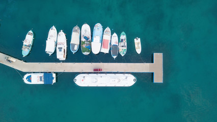 Aerial view on the harbor with boats and yachts. Beautiful composition with sea transport