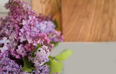 Lilac spring bouquet and olive cutting boards