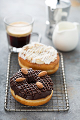 Chocolate and almond donuts with coffee