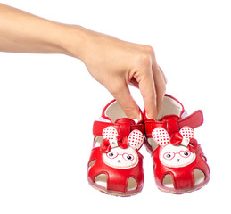 Baby shoes sandals in hand rope on white background isolation