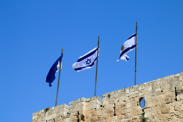 View of the Israeli national flag at the Jaffa Gate in Jerusalem, Israel.