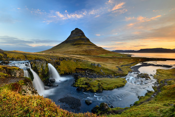 Amazing Icelandic landscape at the top of Kirkjufellsfoss waterfall with Kirkjufell mountain in the background on the north coast of Iceland Snaefellsnes peninsula
