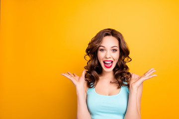 Wow, yes, omg! Portrait with copy space empty place of astonished impressed girl with hairdo yelling wide open mouth isolated on yellow background having fun celebrating achievement