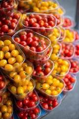 Red and yellow cherry tomatoes at the Farmers Market Paris