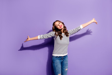 Portrait of crazy lovely joyful girl open hands to the side chilling dancing having motivation inspiration energy isolated on violet background