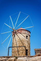 Closeup Windmill in the harbor of Rhodes island, Rhodes Greece