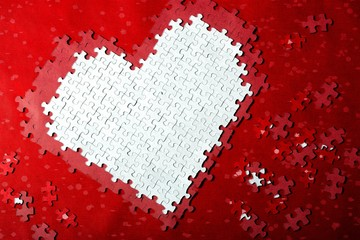 Valentine Heart Made of out Puzzle Pieces in Red and White