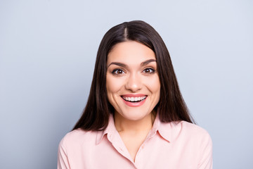 Portrait of pretty, charming, cute, nice, gorgeous woman in classic shirt laughing with healthy white beaming smile isolated on grey background looking at camera