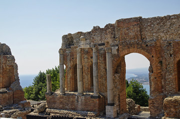 Ruins of the Greek Roman Theater destroyed with Etna erupting, Taormina, Sicily, Italy
