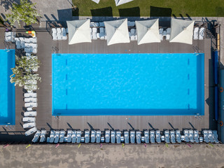 pool in mediterranean garden architecture in top view. Photo from the drone