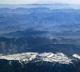 Aerial view of mountain ranges receding to the horizon