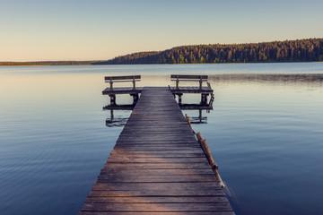 Obraz Wooden footbridge on the lake - fototapety do salonu