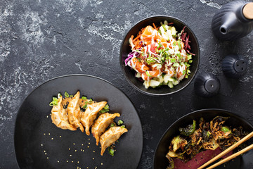 Asian cuisine dishes on the table overhead view