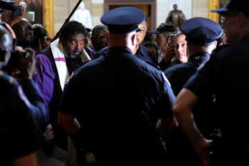 Organizers and clergy hold a Poor People's Campaign rally at the U.S. Capitol