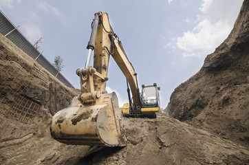 Big machinery used to excavate huge amounts of earth in construction sites