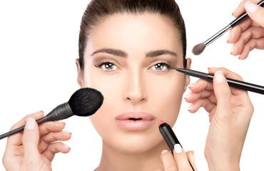 Makeup concept. Gorgeous woman with makeup tools