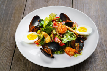 Appetizing gourmet Mediterranean seafood salad with shrimps and mussels, appetizer, banquet, restaurant menu, dining concept