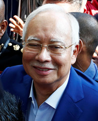 Malaysia's former prime minister Najib Razak arrives to give a statement to the Malaysian Anti-Corruption Commission (MACC) in Putrajaya