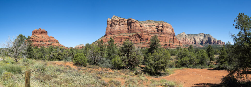 Panorama view of Bell Rock and Courthouse Butte from Red Rock Scenic Byway in Sedona, Arizona